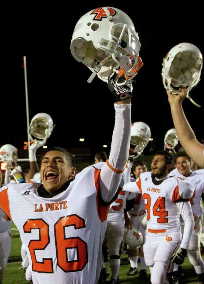 La Porte's Tommy Banda (26) celebrates with teammates after the Bulldogs defeated Katy 9-7 in Class 5A Div. II Region III semifinal high school playoff action at Tully Stadium Saturday, Nov. 26, 2011, in Houston. Photo: Smiley N. Pool, Houston Chronicle / © 2011  Houston Chronicle