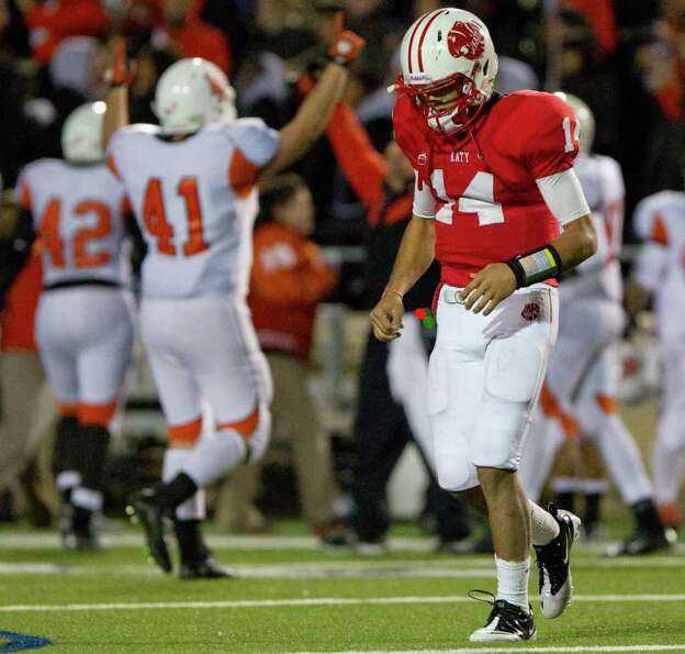 La Porte linebacker Chad Sutherland (41) celebrates as Katy quarterback Brooks Haack (14) walks off