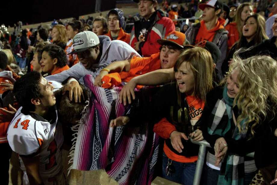 La Porte quarterback Josh Vidales (14) celebrates with fans after the Bulldogs defeated Katy 9-7 in Class 5A Div. II Region III semifinal high school playoff action at Tully Stadium Saturday, Nov. 26, 2011, in Houston. Photo: Smiley N. Pool, Houston Chronicle / © 2011  Houston Chronicle