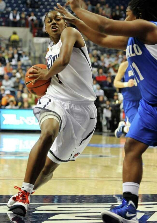 Connecticut's Tiffany Hayes drives to the basket while guarded by Buffalo's Ephesia Holmes, right, in the first half of an NCAA college basketball game in Storrs, Conn., Saturday, Nov. 26, 2011. Hayes was top scorer for UConn with 30 points as Connecticut won 90-34. (AP Photo/Jessica Hill) Photo: Jessica Hill, Associated Press / AP2011