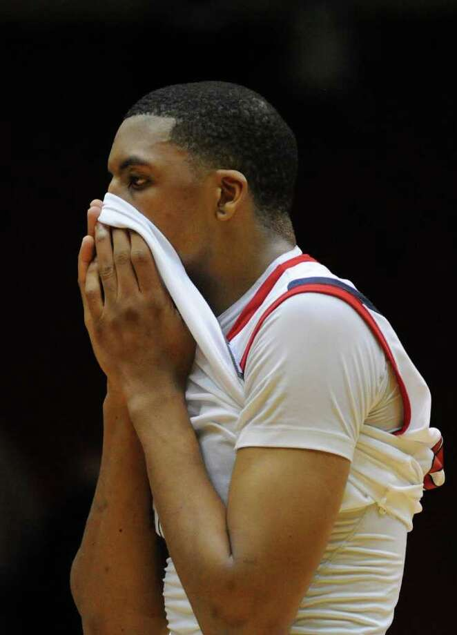 Houston Cougars guard J.J. Thompson (3) stands in disbelief with his jersey pulled over his mouth as TCU won on a last minute shot  in a NCAA mens basketball game on November 26, 2011 at Hofheinz Pavilion  in Houston, Texas. Photo: Thomas B. Shea, For The Chronicle / © 2011 Thomas B. Shea