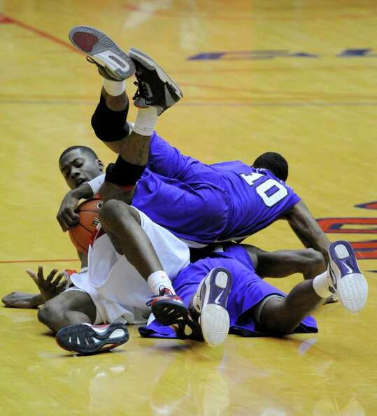 Houston Cougars forward Jonathon Simmons (23) gets a loose ball as TCU Horned Frogs guard Hank Thorn