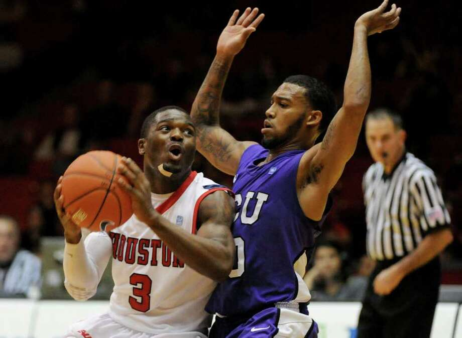 Nov. 26: TCU 81, UH 80Houston Cougars forward Jonathon Simmons (23) shoulders against TCU Horned Frogs guard Hank Thorns (10) in a NCAA mens basketball game on November 26, 2011 at Hofheinz Pavilion  in Houston, Texas. Photo: Thomas B. Shea, For The Chronicle / © 2011 Thomas B. Shea