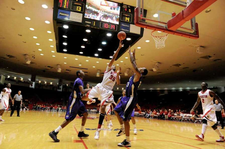 Houston Cougars forward TaShawn Thomas (35) is fouled by TCU Horned Frogs center Cheick Kone (13) in