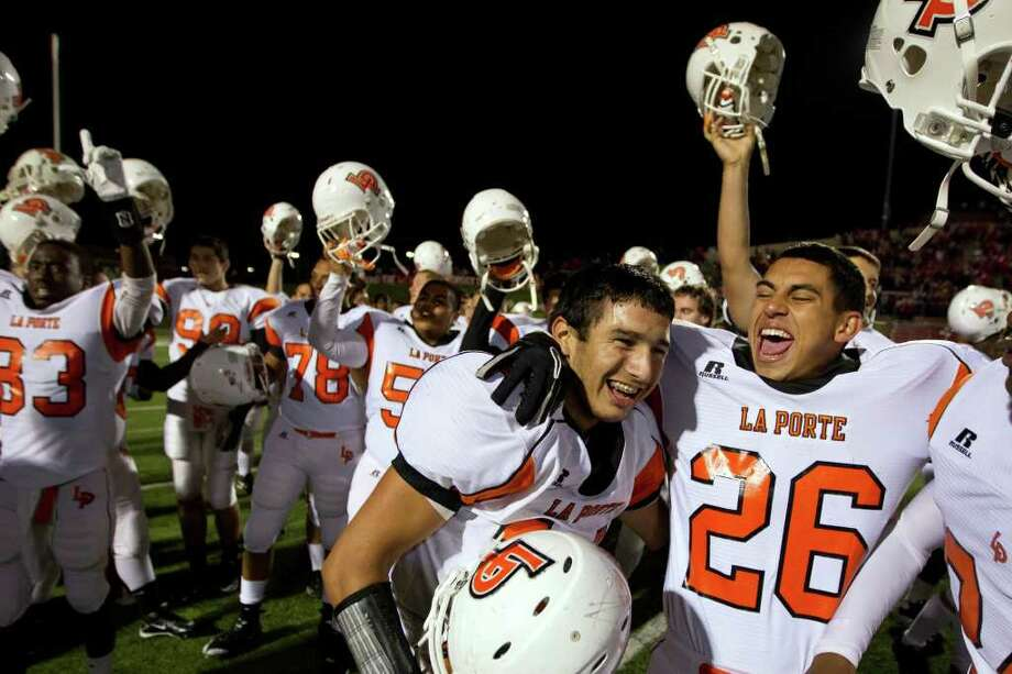 SMILEY N. POOL: CHRONICLE HOW 'BOUT THEM BULLDOGS?: La Porte quarterback Josh Vidales (14) celebrates with Tommy Banda (26) after the Bulldogs upset Class 5A power Katy 9-7 on Saturday. Photo: Smiley N. Pool / © 2011  Houston Chronicle
