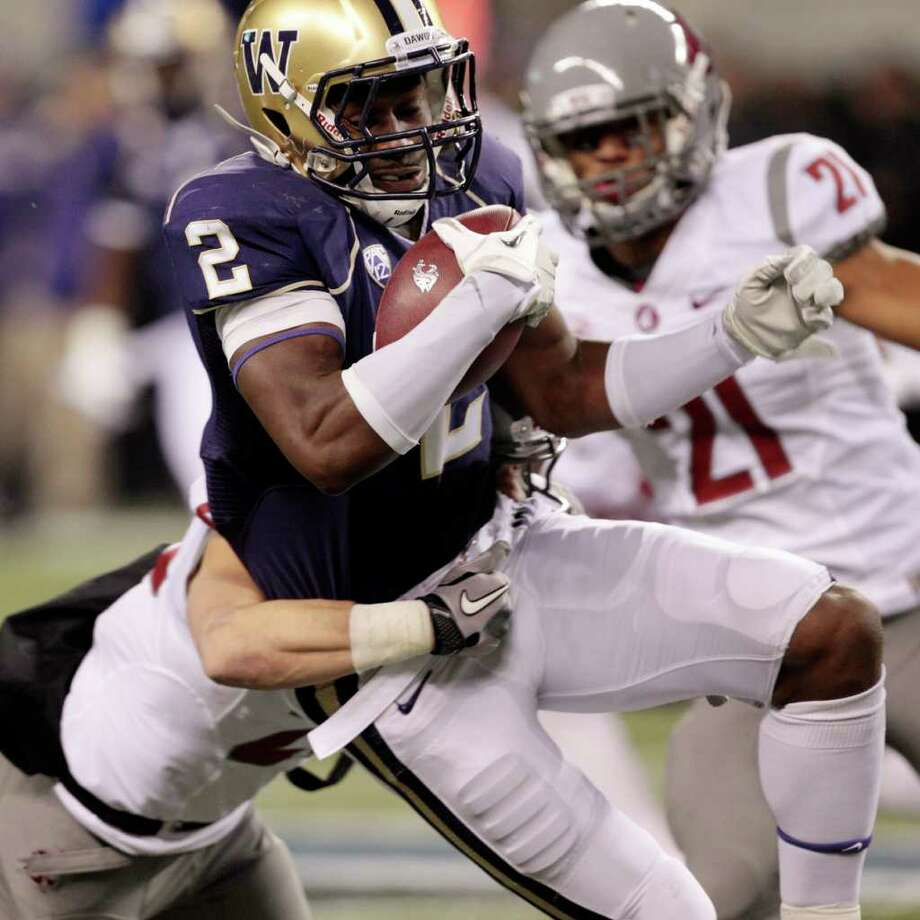 Washington's Kasen Williams (2) is brought down on a punt return against Washington State in the first half of an NCAA college football game on Saturday, Nov. 26, 2011, in Seattle. Photo: AP