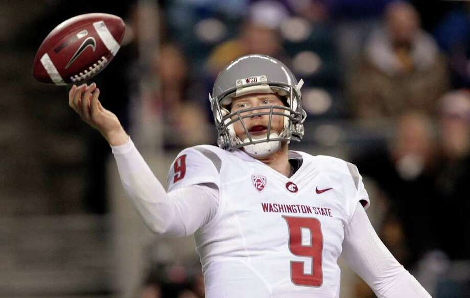 Washington State quarterback Marshall Lobbestael watches the ball flip past him on the team's first play against Washington in an NCAA college football game, Saturday, Nov. 26, 2011, in Seattle. Photo: AP
