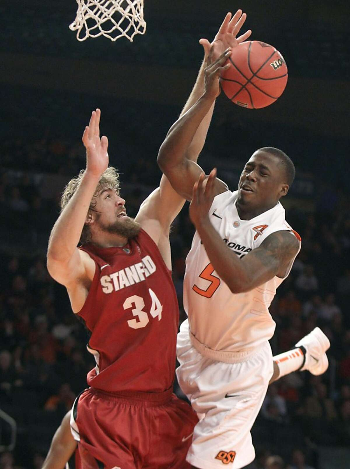 Stanford forward Andrew Zimmerman, left, blocks a shot by Oklahoma State guard Reger Dowell in the second half of an NIT Season Tip-Off college basketball tournament game at New York's Madison Square Garden, Wednesday, Nov. 23, 2011. Stanford won 82-67. (AP Photo/Richard Drew) Ran on: 11-24-2011 Stanford forward Andrew Zimmerman gets in the way of Oklahoma State guard Reger Dowell. Ran on: 11-24-2011 Stanford forward Andrew Zimmerman gets in the way of Oklahoma State guard Reger Dowell.