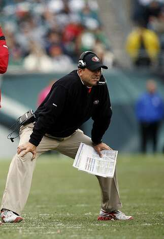 PHILADELPHIA, PA - OCTOBER 2: Head coach Jim Harbaugh of the San Francisco 49ers looks on in the second quarter against the Philadelphia Eagles during an NFL football game at Lincoln Financial Field on October 2, 2011 in Philadelphia, Pennsylvania. The 49ers defeated the Eagles 24-23. (Photo by Rich Schultz /Getty Images)  Ran on: 10-03-2011 &quo;Cold-blooded game from him,'' 49ers head coach Jim Harbaugh said of his quarterback, Alex Smith. Ran on: 10-03-2011 &quo;Cold-blooded game from him,'' 49ers head coach Jim Harbaugh said of his quarterback, Alex Smith. Ran on: 10-03-2011 &quo;Cold-blooded game from him,'' 49ers head coach Jim Harbaugh said of his quarterback, Alex Smith. Photo: Rich Schultz, Getty Images