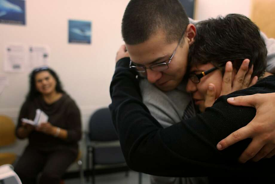 Season of Sharing recipients, Antonio and Joshua Madeiros, 16, hug and joke around after a positive checkup at UCSF Medical Center on Monday Nov. 21, 2011 in San Francisco, Calif. SOS help their mother with the deposit on a bigger apartment when she was told her son Antonio would need his own room following a kidney transplant. Photo: Mike Kepka, The Chronicle