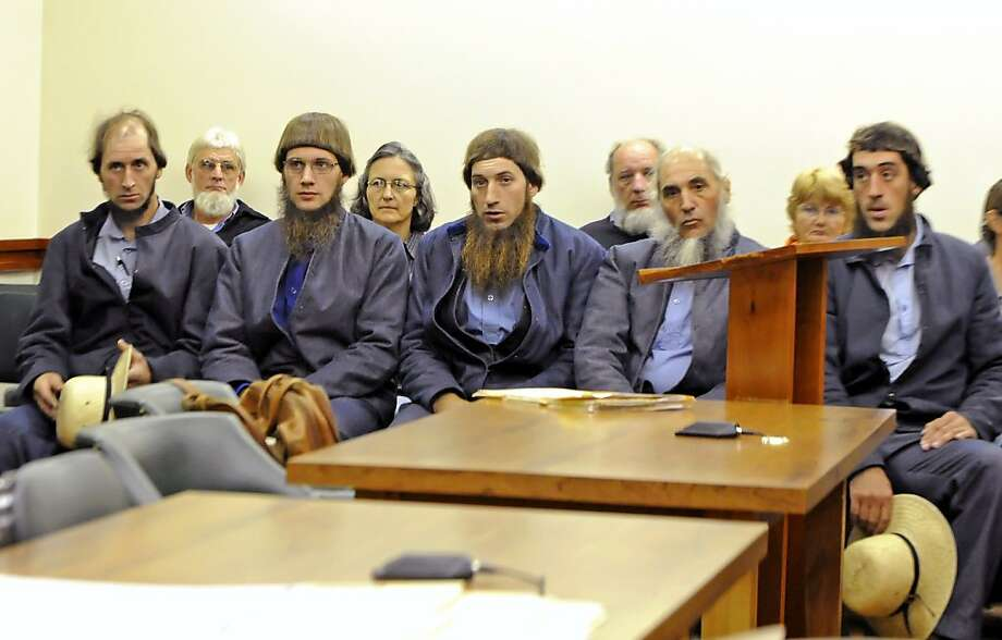 FILE - In this Oct. 19, 2011 file photo, from left: Johnny Mullet, Lester Mullet, Daniel Mullet, Levi Miller and Eli Miller wait to make their pleas in Holmes County Municipal Court in Millersburg, Ohio. The five men, along with reputed Amish breakaway sect leader Sam Mullet and Emanuel Shrock, were arrested by the FBI and local sheriff's deputies early Wednesday, Nov. 23, 2011 on federal hate crime charges. (AP Photo/Mike Schenck, Wooster Daily Record, File) Photo: Mike Schenk, AP