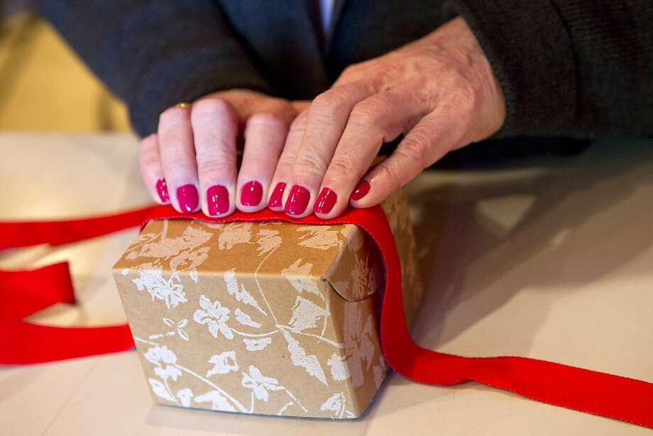 Paulette Knight uses organic cotton ribbon to wrap a box in an eco-friendly way at her store The Ribbonerie in San Francisco, Calif., on Thursday, November 17, 2011. Photo: Laura Morton, Special To The Chronicle