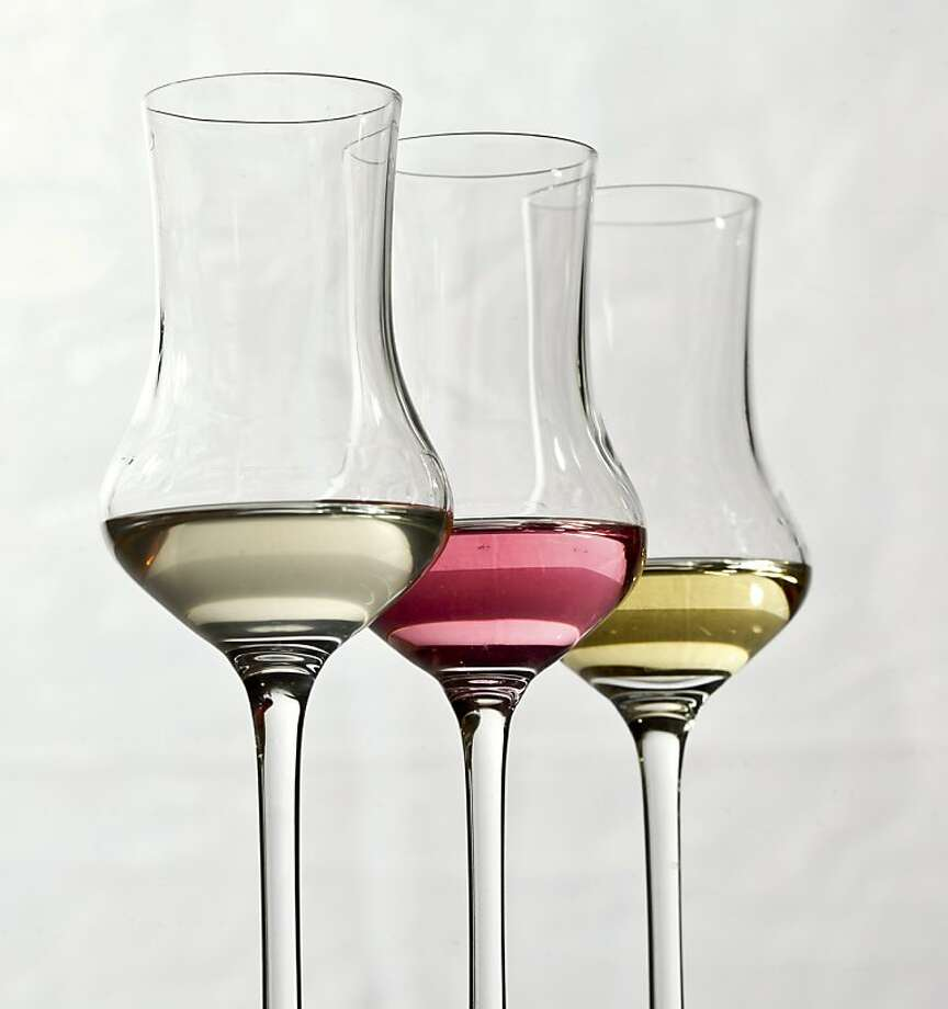 A flight of grappa at Estate in Sonoma, Calif., is seen on Monday, Oct. 24, 2011.  From left are Poli Miele, Rosolio Alla Rosa, and lo Chardonnay di Nonino Grappa. Photo: Russell Yip, The Chronicle