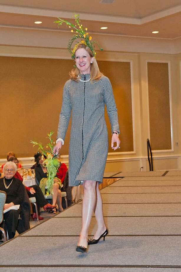 Trish Turner on the runway during the fashion show at Couture et Fleurs, the San Francisco Garden Club's annual fundraising event, which featured an elegant luncheon at the Four Seasons Hotel and a runway fashion show, which showcased fashions by San Francisco clothing designer Robert Berry and exotic floral accessories designed by City College of San Francisco students in the department of Environmental Horticultural and Floristry Fashion Show - Trish Turner Photo: Susana Bates / Drew Altizer, Susana Bates For Drew Altizer