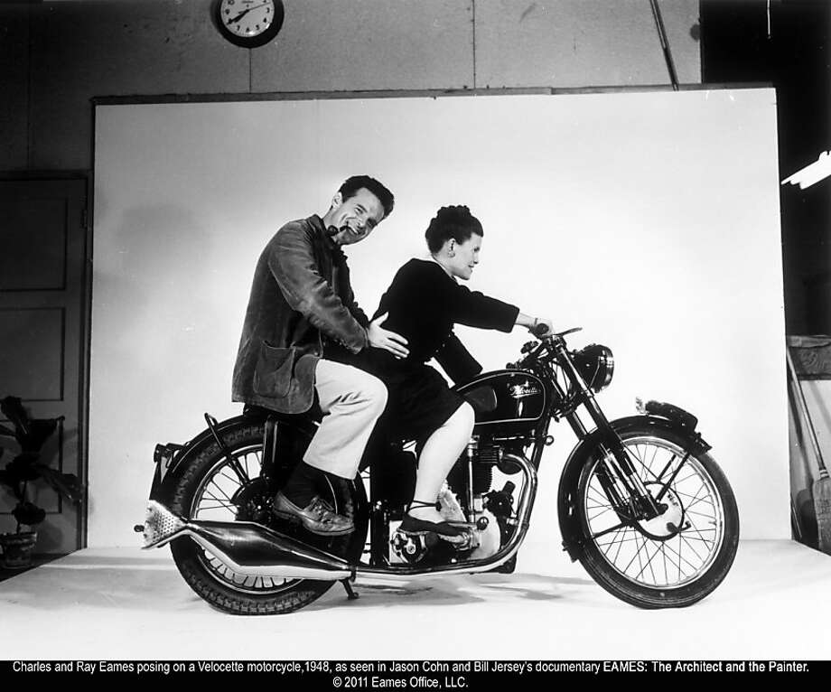 Charles and Ray Eames on Velocette motorcycle in EAMES: THE ARCHITECT & THE PAINTER Charles and Ray Eames posing on a Velocette motorcycle,1948, as seen in Jason Cohn and Bill Jersey's documentary EAMES: The Architect and the Painter. © 2011 Eames Office, LLC. Photo: First Run Features, Firstrunfeatures.com