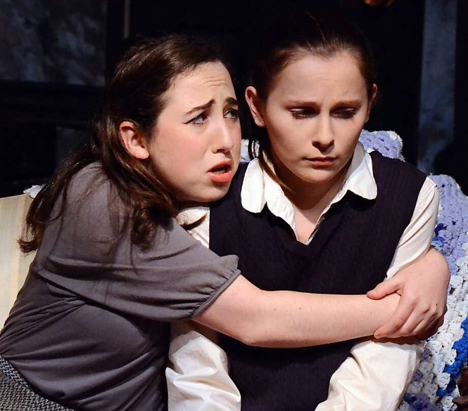 "The unstable daughter Ruth (Alona Bach) comforts her gifted, pathologically shy sister Tillie (Julie Belanoff) in Custom Made's production of ""The Effect of Gamma Rays on Man-in-the-Moon Marigolds"" Photo: Jay Yamada"