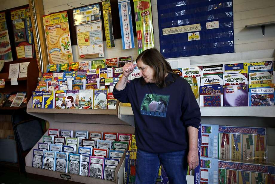 Carolynn Ghiorso (cq) and her husband Mike have owned Educational Exchange, a teacher supply store in Richmond, for the past 34 years.  The shop, which has been there for 40 years, will be closing its doors at the end of November.  Ghiorso works their 50% off sale in San Francisco, Calif., Friday, November 18, 2011.  Ran on: 11-25-2011 Carolynn Ghiorso, who owns the Educational Exchange along with her husband, Mike, says it has become impossible for the Richmond District store to compete with big chain stores. Photo: Sarah Rice, Special To The Chronicle