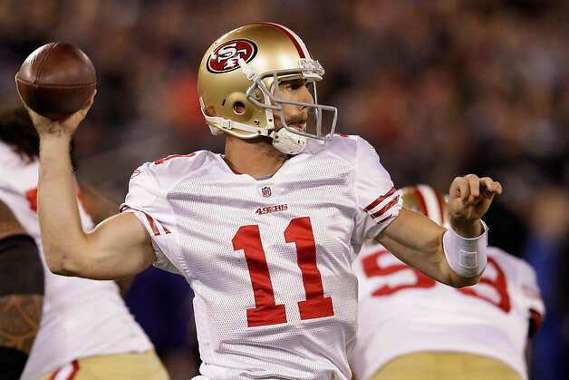 BALTIMORE, MD - NOVEMBER 24:   Alex Smith #11 of the San Francisco 49ers drops back to pass against the Baltimore Ravens at M&T Bank Stadium on November 24, 2011 in Baltimore, Maryland.  (Photo by Rob Carr/Getty Images) Photo: Rob Carr, Getty Images