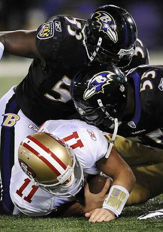 San Francisco 49ers quarterback Alex Smith (11) is sacked by Baltimore Ravens defenders Jameel McClain (53) and Terrell Suggs in the first half of an NFL football game in Baltimore on Thursday, Nov. 24, 2011. (AP Photo/Nick Wass) Photo: Nick Wass, AP