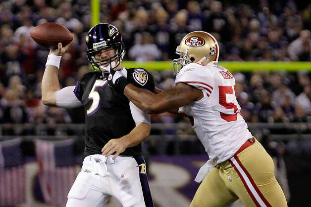 BALTIMORE, MD - NOVEMBER 24:    Ahmad Brooks #55 of the San Francisco 49ers grabs the face mask of Joe Flacco #5 of the Baltimore Ravens at M&T Bank Stadium on November 24, 2011 in Baltimore, Maryland.  (Photo by Rob Carr/Getty Images) Photo: Rob Carr, Getty Images