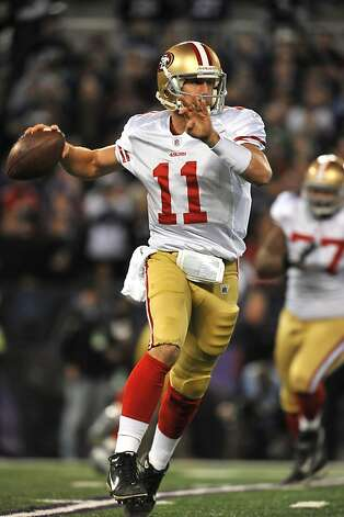 BALTIMORE - NOVEMBER 24:  Alex Smith #11 of the San Francisco 49ers looks for a receiver against the Baltimore Ravens at M&T Bank Stadium on November 24. 2011 in Baltimore, Maryland.  (Photo by Larry French/Getty Images) Photo: Larry French, Getty Images