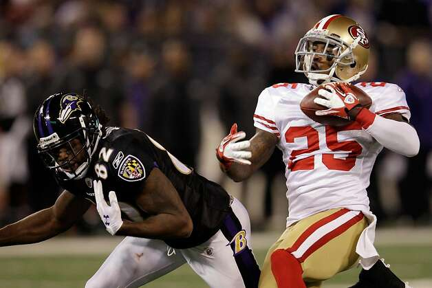 BALTIMORE, MD - NOVEMBER 24:  Tarell Brown #25 of the San Francisco 49ers intercepts a pass intended for  Torrey Smith #82 of the Baltimore Ravens during the first half at M&T Bank Stadium on November 24, 2011 in Baltimore, Maryland. Brown was called for pass interference on the play.  (Photo by Rob Carr/Getty Images) Photo: Rob Carr, Getty Images