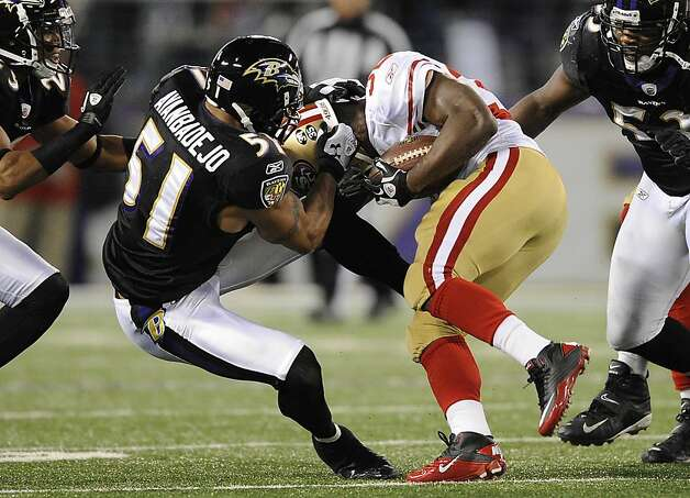 Baltimore Ravens linebacker Brendon Ayanbadejo (51) tackles San Francisco 49ers running back Kendall Hunter by his helmet in the second half of an NFL football game in Baltimore on Thursday, Nov. 24, 2011. (AP Photo/Nick Wass) Photo: Nick Wass, AP