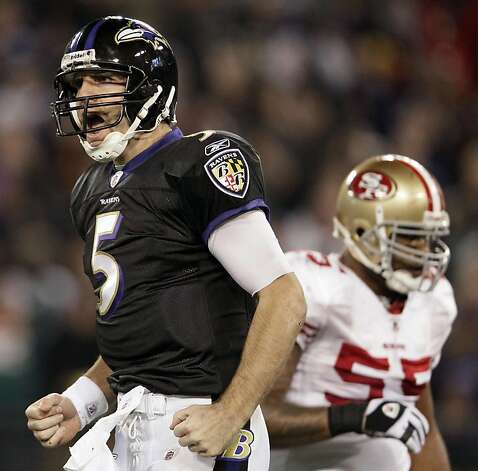 Baltimore Ravens quarterback Joe Flacco, left, reacts after throwing a touchdown pass to tight end Dennis Pitta in the second half of an NFL football game against the San Francisco 49ers in Baltimore on Thursday, Nov. 24, 2011. (AP Photo/Patrick Semansky) Photo: Patrick Semansky, AP