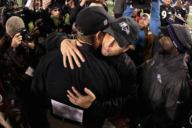 BALTIMORE, MD - NOVEMBER 24:  Head coach Jim Harbaugh of the San Francisco 49ers (L) hugs his brother head coach John Harbaugh of the Baltimore Ravens (R) after the Ravens defeated the 49ers 16-6 at M&T Bank Stadium on November 24, 2011 in Baltimore, Maryland.  (Photo by Rob Carr/Getty Images) Photo: Rob Carr, Getty Images