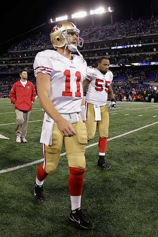 BALTIMORE, MD - NOVEMBER 24:  Alex Smith #11 of the San Francisco 49ers and teammate Ahmad Brooks #55 walk off the field after losing to the Baltimore Ravens 16-6 at M&T Bank Stadium on November 24, 2011 in Baltimore, Maryland.  (Photo by Rob Carr/Getty Images) Photo: Rob Carr, Getty Images