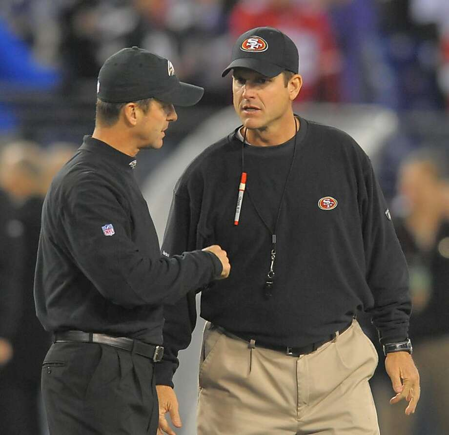 Ravens head coach, John Harbaugh (left) and San Francisco 49ers head coach Jim Harbaugh chat at mid-field prior to their game on Thursday, November 24, 2011, in Baltimore, Maryland. It's the first time in NFL history that two brothers have opposed each other as coaches.  (Doug Kapustin/MCT) Photo: Doug Kapustin, MCT