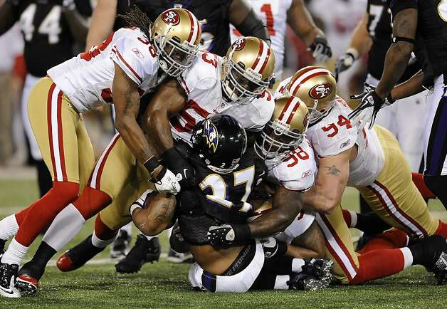 San Francisco 49ers defenders tackle Baltimore Ravens running back Ray Rice (27) as he rushes the ball in the first half of an NFL football game in Baltimore, Thursday, Nov. 24, 2011. (AP Photo/Nick Wass) Photo: Nick Wass, AP