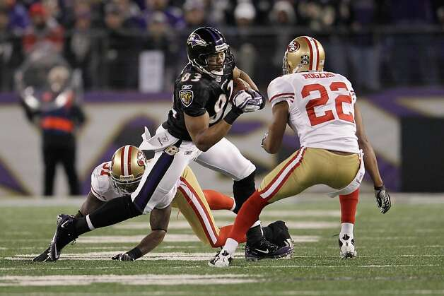 BALTIMORE, MD - NOVEMBER 24:  Donte Whitner #31 of the San Francisco 49ers and teammate  Carlos Rogers #22 try to tackle Lee Evans #83 of the Baltimore Ravens during the second half at M&T Bank Stadium on November 24, 2011 in Baltimore, Maryland.  (Photo by Rob Carr/Getty Images) Photo: Rob Carr, Getty Images