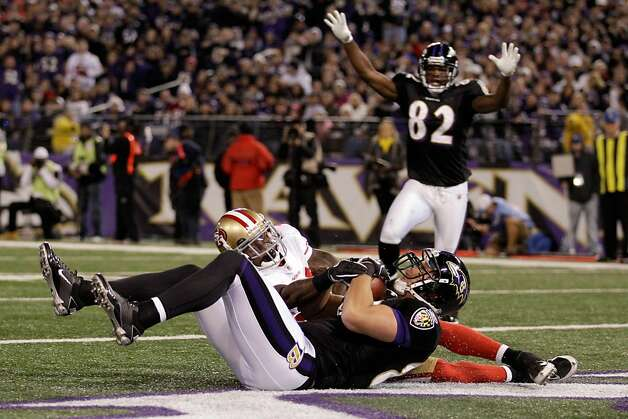 BALTIMORE, MD - NOVEMBER 24:  Dennis Pitta #88 of the Baltimore Ravens catches a touchdown pass in front of  Donte Whitner #31 of the San Francisco 49ers as Torrey Smith #82 of the Ravens celebrates during the second half at M&T Bank Stadium on November 24, 2011 in Baltimore, Maryland.  (Photo by Rob Carr/Getty Images) Photo: Rob Carr, Getty Images