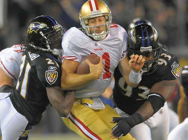 San Francisco 49ers quarterback Alex Smith is sandwiched by Baltimore Ravens cornerback Lardarius Webb (21), and defensive end Cory Redding (93) in the second half of their game on Thursday, November 24, 2011, in Baltimore, Maryland. The Ravens come away with a 16-6 win over the 49ers.  (Doug Kapustin/MCT) Photo: Doug Kapustin, MCT