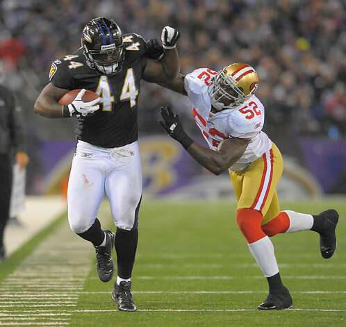 Baltimore Ravens fullback Vonta Leach fends off San Francisco 49ers inside linebacker Patrick Willis as he picks up a first down following a reception in the second half of their game on Thursday, November 24, 2011, in Baltimore, Maryland. The Ravens come away with a 16-6 win over the 49ers.  (Doug Kapustin/MCT) Photo: Doug Kapustin, MCT