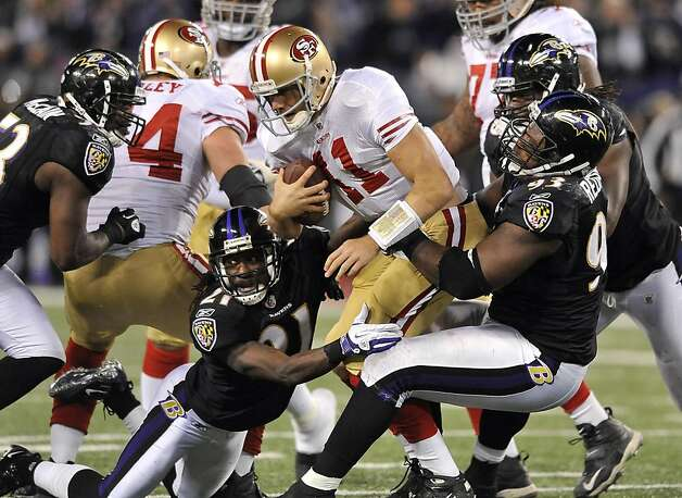 San Francisco 49ers quarterback Alex Smith, center, is sacked by a group of Baltimore Ravens defenders in the second half of an NFL football game in Baltimore, Thursday, Nov. 24, 2011. Baltimore won 16-6. (AP Photo/Gail Burton) Photo: Gail Burton, AP