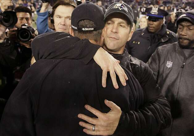 Baltimore Ravens head coach John Harbaugh,foreground, hugs his brother, San Francisco 49ers head coach Jim Harbaugh, after their NFL football game in Baltimore on Thursday, Nov. 24, 2011. Baltimore won 16-6. (AP Photo/Patrick Semansky)  Ran on: 11-25-2011 The brothers Harbaugh embrace on the field after the Ravens gave John Harbaugh (right) bragging rights. Ran on: 11-25-2011 The brothers Harbaugh embrace on the field after the Ravens gave John Harbaugh (right) bragging rights. Photo: Patrick Semansky, AP
