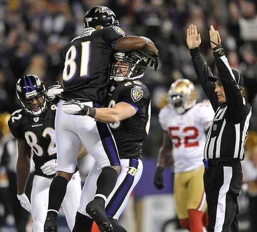 Baltimore Ravens tight end Dennis Pitta, center, celebrates his touchdown with teammates Anquan Boldin (81) and Torrey Smith (82) in the second half of an NFL football game against the San Francisco 49ers in Baltimore on Thursday, Nov. 24, 2011. (AP Photo/Gail Burton)  Ran on: 11-25-2011 The Ravens' Anquan Boldin (81) feels uplifted in the arms of Dennis Pitta after Pitta scored the game's only touchdown. Photo: Gail Burton, AP