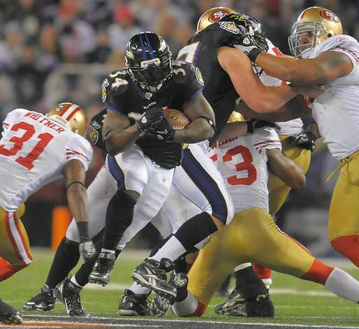 Baltimore Ravens running back Ricky Williams finds a hole in the 49ers defense to pick up a first down in the second half of their game on Thursday, November 24, 2011, in Baltimore, Maryland. The Ravens come away with a 16-6 win over the 49ers.  (Doug Kapustin/MCT) Photo: Doug Kapustin, MCT