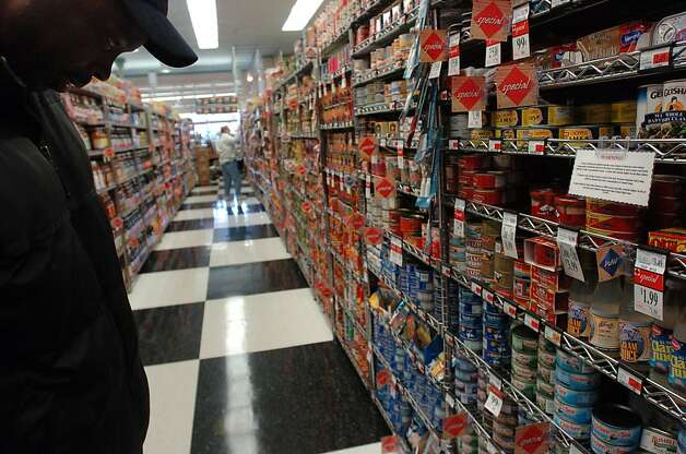 TUNA_02_EAL.JPG Art Clark of Berkeley looks at the canned fish for sale at Andronico's on Telegraph in Berkeley Friday afternoon, March 17, 2006. Andronico's is one of few grocery stores that post signs warning consumers about the dangers of mercury. CQ Event on 3/17/06 in Berkeley. Erin Lubin / For the Chronicle  Ran on: 08-23-2011 Upscale Andronico's, which filed for Chapter 11 bankruptcy, got bogged down by debt during an aggressive expansion. Photo: Erin Lubin, Special To The Chronicle