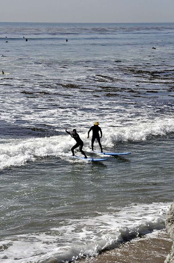 Richard Schmidt, perhaps Santa Cruz's best-known surfing instructor, takes a beginner's class out at Pleasure Point.  Richard Schmidt, perhaps Santa Cruz's best-known surfing instructor, takes a beginner's class out at Pleasure Point. Christine Delsol / Special to The Chronicle  ONE-TIME USE; CONTACT PHOTOGRAPHER FOR REUSE Photo: Christine Delsol, Special To The Chronicle