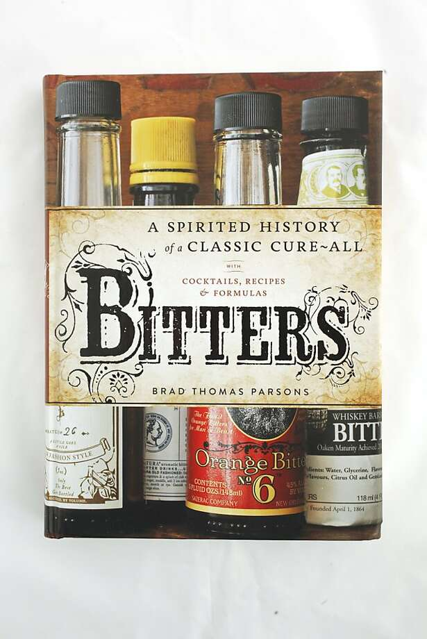 """Bitters"" as seen in San Francisco, California, on Wednesday, November 16, 2011.   Ran on: 11-27-2011 Photo caption Dummy text goes here. Dummy text goes here. Dummy text goes here. Dummy text goes here. Dummy text goes here. Dummy text goes here. Dummy text goes here. Dummy text goes here.###Photo: GIFTGUIDE27_bitters_ph1321228800SFC###Live Caption:""Bitters: A Spirited History of a Classic Cure-All"" by Brad Thomas Parsons###Caption History:""Bitters"" as seen in San Francisco, California, on Wednesday, November 16, 2011.###Notes:###Special Instructions: Photo: Craig Lee, Special To The Chronicle"