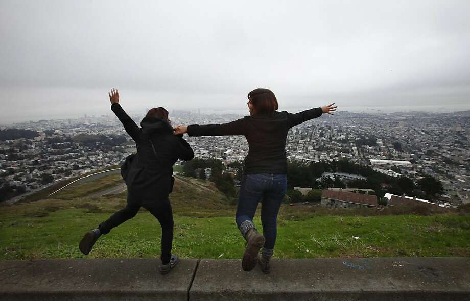 Sisters Mallory (l to r) and Sonora Gonzalez play around for a photo as they take in the view of San Francisco from Twin Peaks on Friday, November 25, 2011 in San Francisco, Calif. Photo: Lea Suzuki, The Chronicle