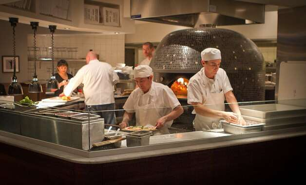 Cooks prepare dinner in the kitchen at Cupola Restaurant in San Francisco, Calif., is seen on November 16th, 2011. Photo: John Storey