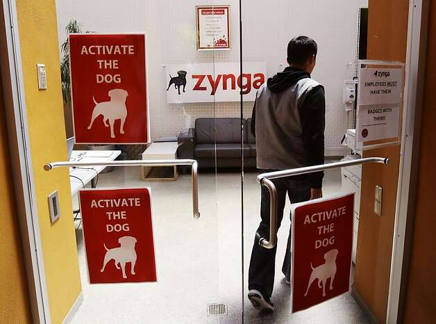 "In this June 2, 2011 photo, workers walk into Zynga headquarters in San Francisco. Based on papers filed Friday, July1, 2011, Zynga, the online game maker behind ""FarmVille"" and other popular Facebook pastimes, is going public. (AP Photo/Paul Sakuma)  Ran on: 07-11-2011 Zynga, with offices in San Francisco, makes some of the most popular online games. It makes money from just a few customers who spend lots buying virtual goods for their games. Photo: Paul Sakuma, AP"