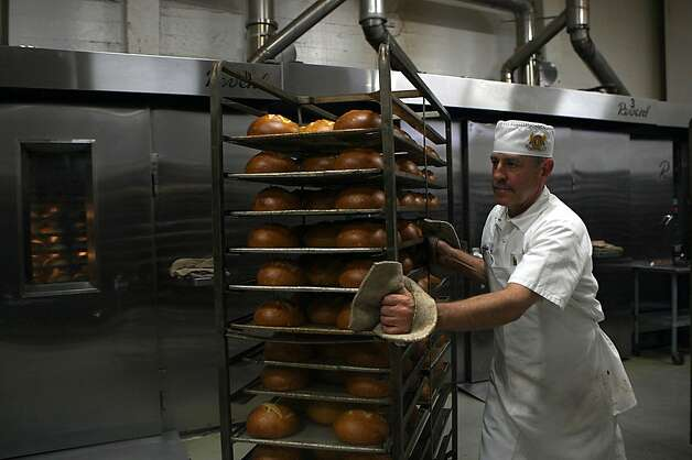 Tony Gomez with soup bowls freshly out of the oven at Boudin Bakery on 10th Ave. in San Francisco, California, on Wednesday, September 14, 2011.  Tony has been working at Boudin for 18 years and helps bake 12,000 or more pieces daily. Photo: Liz Hafalia, The Chronicle