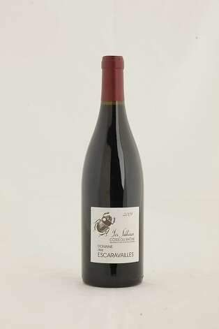2009 Domaine Des Escaravailles Cotes du Rhone Cuvee Les Sablieres as seen in San Francisco, California, on Wednesday, November 16, 2011.   Ran on: 11-27-2011 Photo caption Dummy text goes here. Dummy text goes here. Dummy text goes here. Dummy text goes here. Dummy text goes here. Dummy text goes here. Dummy text goes here. Dummy text goes here.###Photo: GIFTGUIDE27_escara_ph1321228800SFC###Live Caption:2009 Domaine des Escaravailles Les Sablieres Cotes du Rhone Rouge###Caption History:2009 Domaine Des Escaravailles Cotes du Rhone Cuvee Les Sablieres as seen in San Francisco, California, on Wednesday, November 16, 2011.###Notes:###Special Instructions: Photo: Craig Lee, Special To The Chronicle