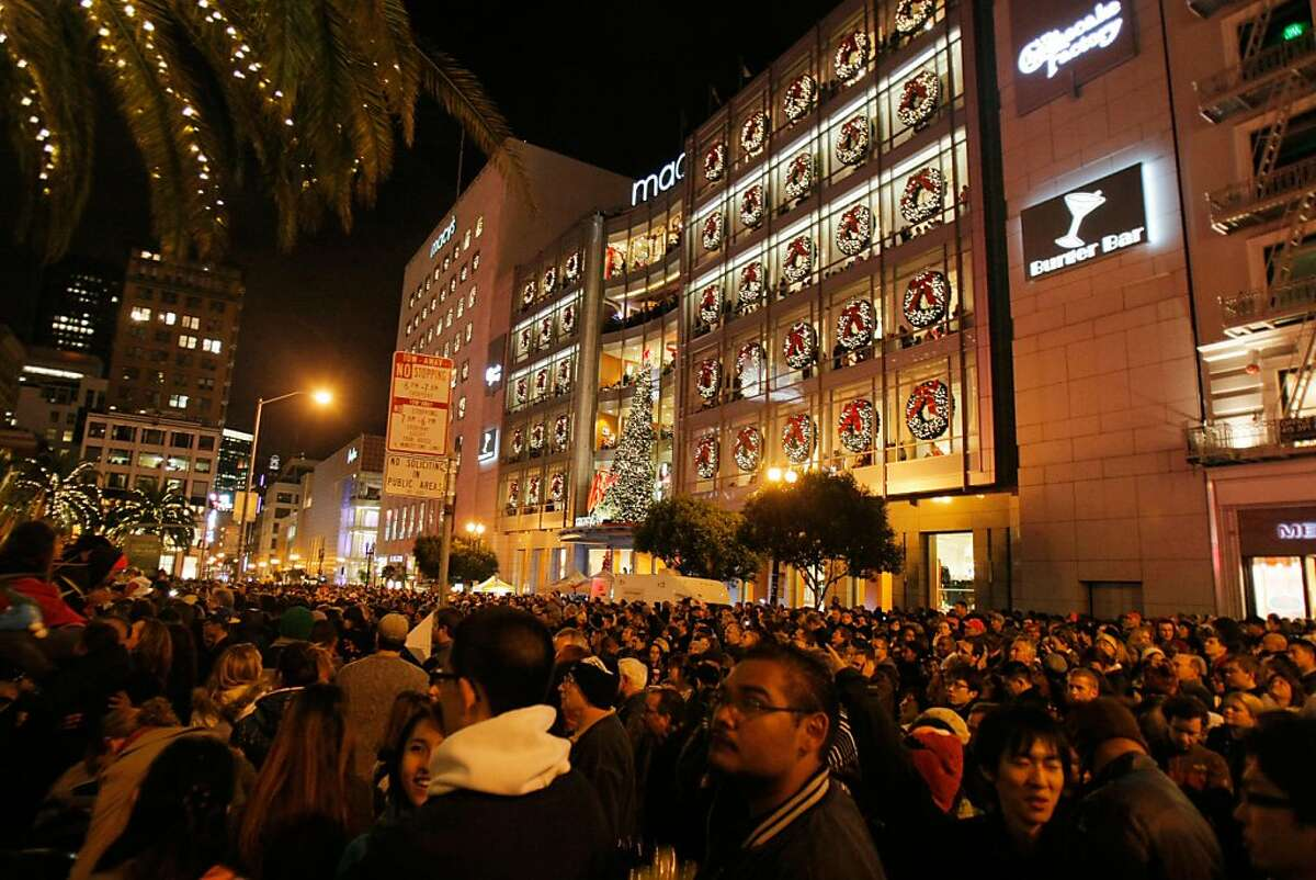 Crowds wait for Macy's Christmas tree to be lit for the first time this holiday season in Union Square in San Francisco, Calif., on Friday, Nov. 25, 2011.