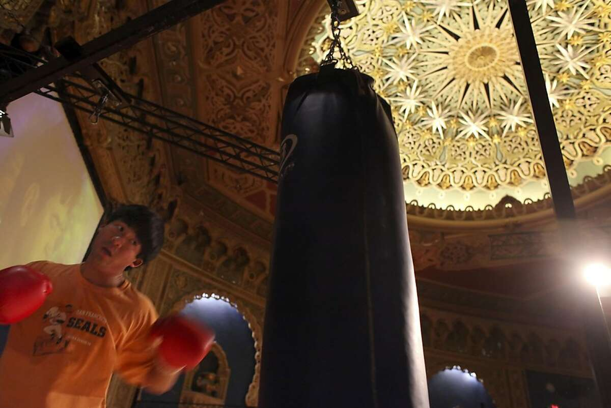 Kevin Teng, 24 gets his cardio workout by boxing at the Crunch Gym, Monday November 21, 2011, in the old Alhambra Theatre in San Francisco, Calif. The theatre was closed in the late 1990's but now serves the neighborhood as a workout facility with Art Deco details.